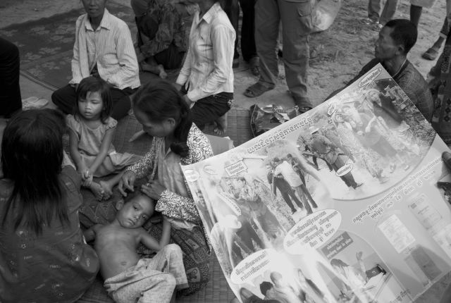 CAMBODIA. Prey Chit (Koh Kong). 23/08/2009: Villager reading a poster about evictions.